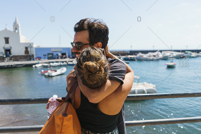Couple embraced in seafront