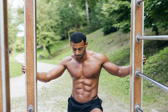 Muscular man posing in park