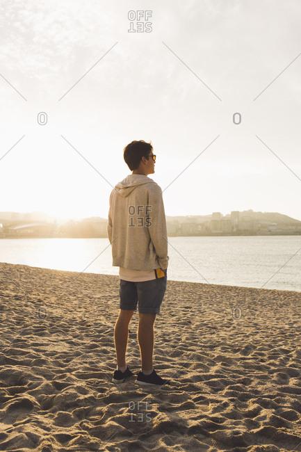 Man posing on beach