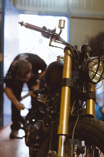 Man working on bike in shop