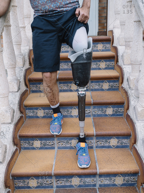 Disable man with a prosthetic equipment