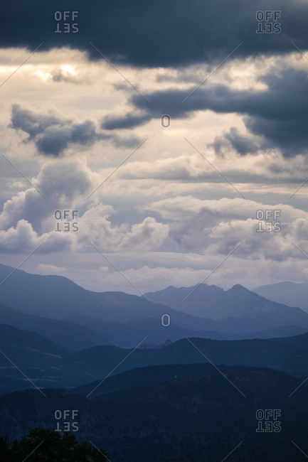 View to hills under cloudy picturesque sky.