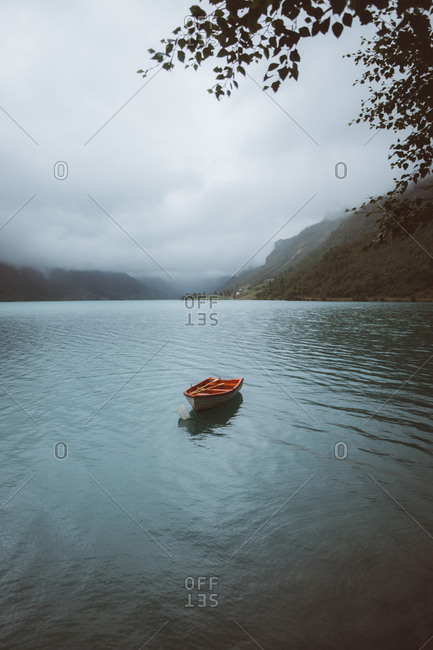 Small rowboat in norwegian fjord