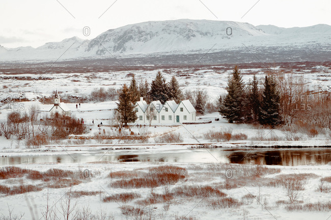 Range of white houses in plain covered with snow.