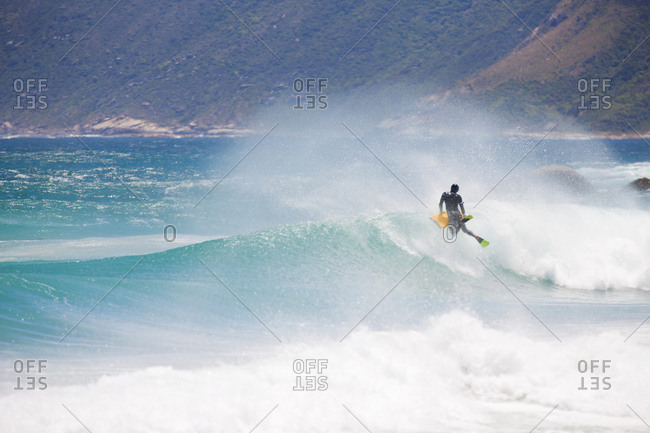 Body boarder riding wave - Offset
