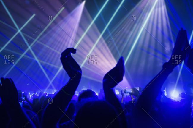 View Of Fans Enjoying Rock Concert With Light Show