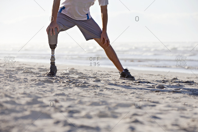 Close Up Of Man With Artificial Leg Exercising On Beach