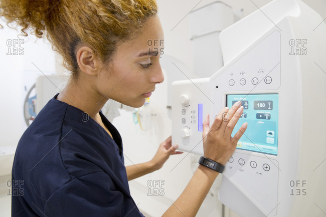 Female Radiographer Working In Hospital X Ray Department