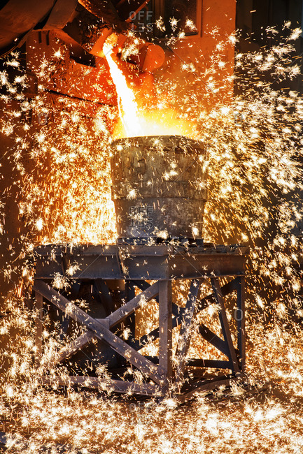 Shower Of Sparks As Molten Metal Is Poured In Steel Foundry