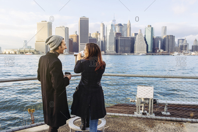Male and female tourists standing at observation point on Brooklyn Promenade
