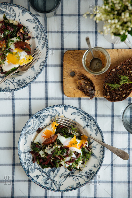 Salads with eggs on plates