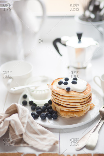 Pancakes with cream and blueberries