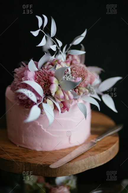 Pink wedding cake with floral top