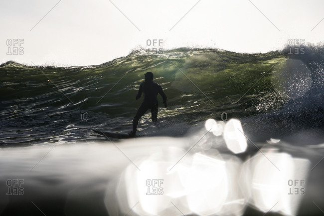 Surfer riding a curling wave