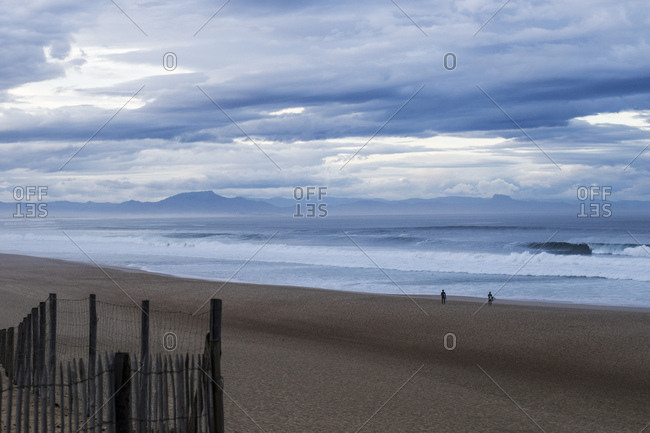 People on a beach under clouds