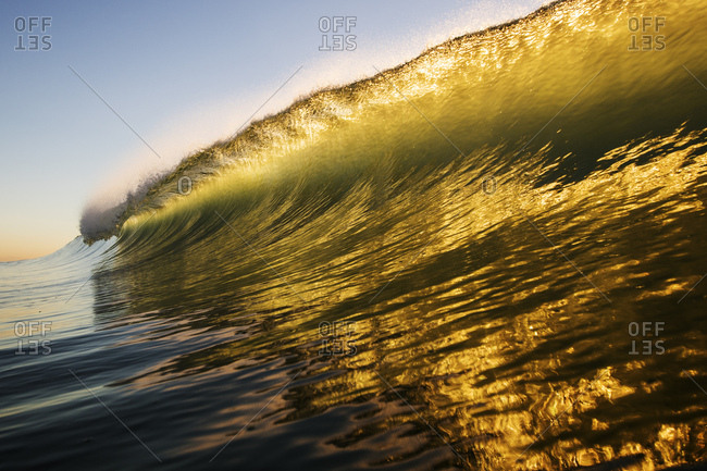 Sunlight streaming through a wave