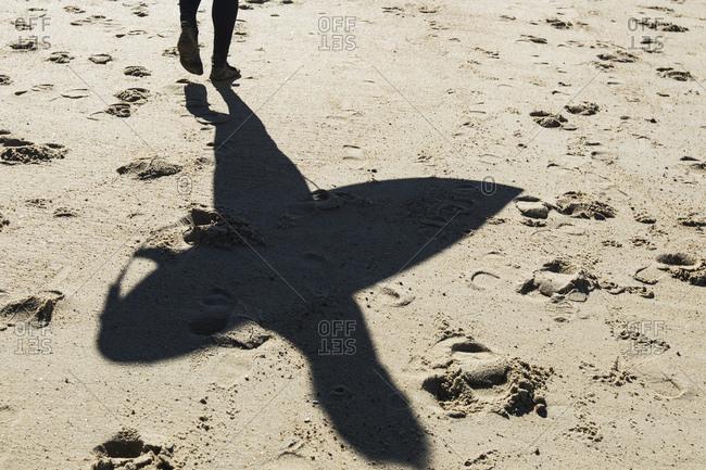 Surfer's shadow on beach