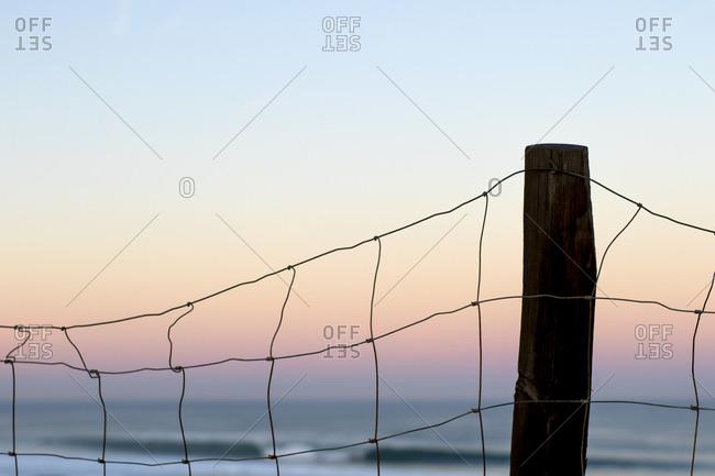 Fence post in ocean setting