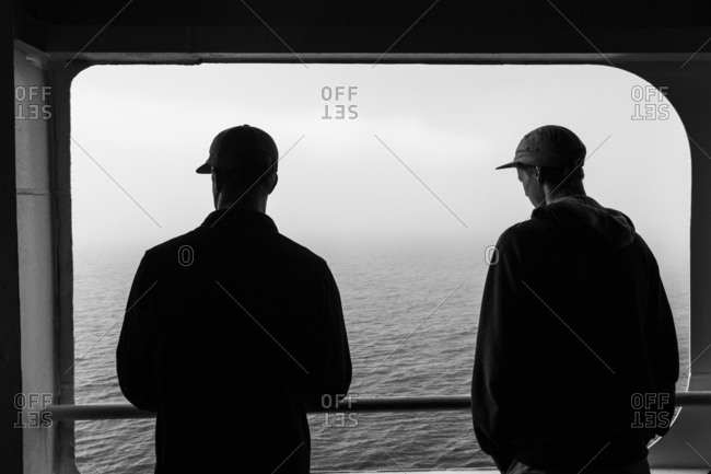 Two young men riding a ferry