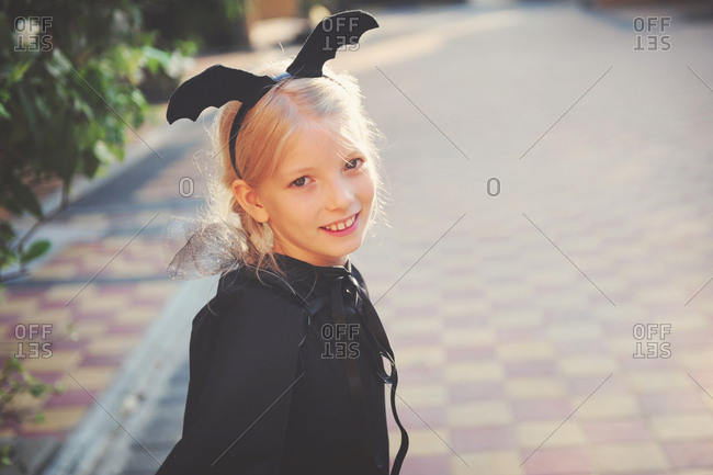 Portrait of a girl wearing a bat costume for Halloween