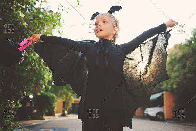 Girl dressed in vampire bat costume for Halloween