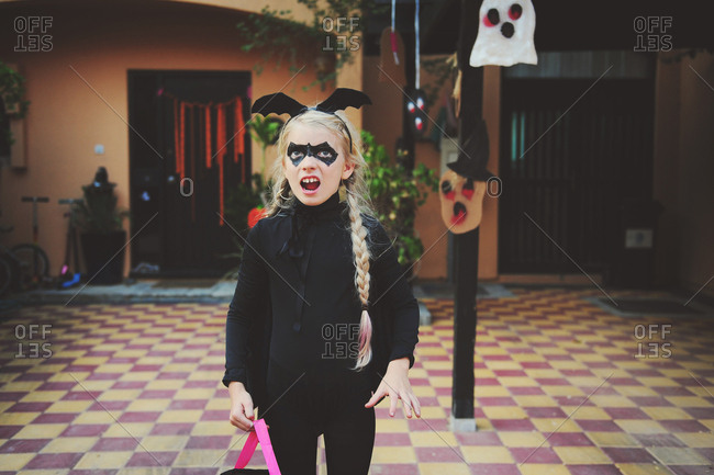 Girl dressed in bat costume for Halloween