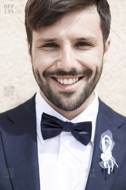 Portrait of bridegroom with bow tie