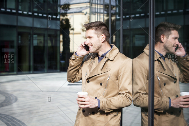Businessman using mobile phone in city