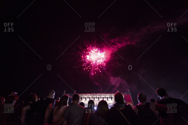 Firework display over buildings in city at night