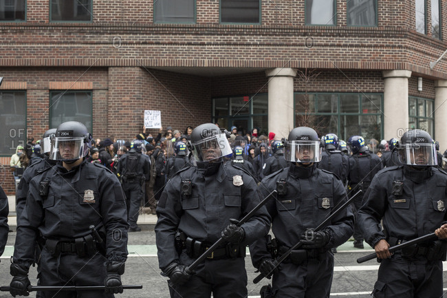 Washington, DC - JANUARY 20, 2017: Riot Police separate protesters from other others being arrested in the background during Donald Trump Inauguration Day Protests