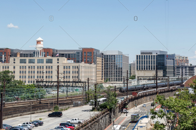 Washington, DC - June 9, 2017: An Amtrak Train pulls into Union Station seen from the Roof deck of the Pullman Place Condominium