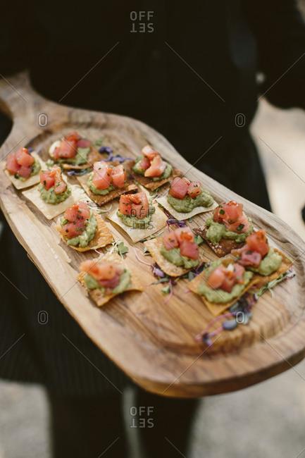 Wooden platter of appetizers