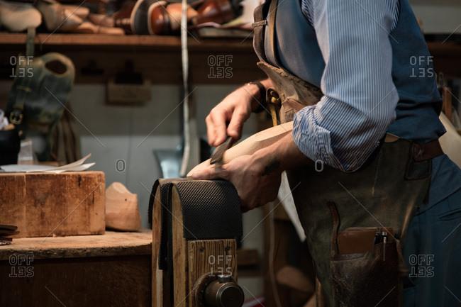 A cobbler at work in a studio