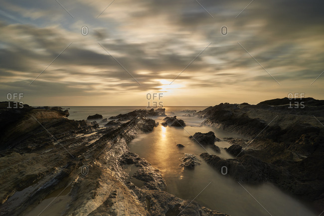 Long exposure of the sunset sky over sea rocks in Jogashima, Miura Peninsula, Japan