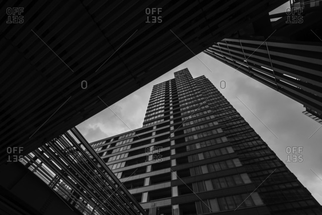 Tokyo, Japan - August 19, 2017: Black and white low angle view of skyscraper in Roppongi area