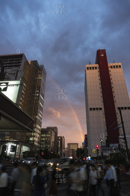 Tokyo, Japan - September 12, 2017: Low angle view of rainbow between skyscrapers in the Tsukiji area at sunset