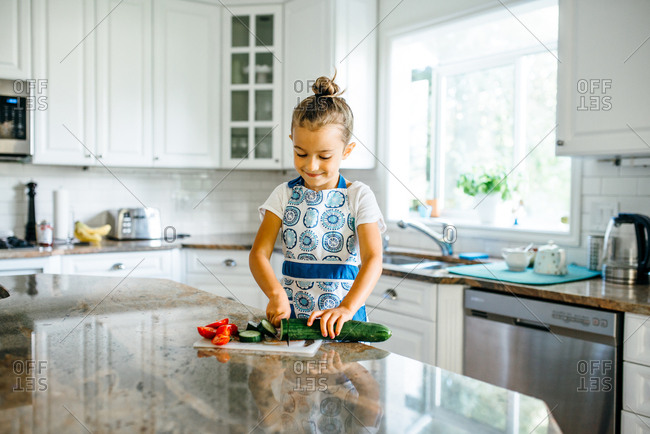 Girl chopping up vegetables