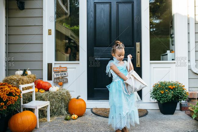 Girl checking her Halloween bag