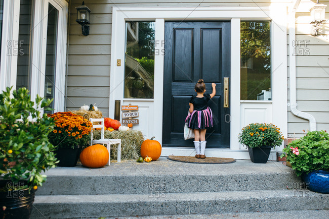 Girl in Halloween dress at door