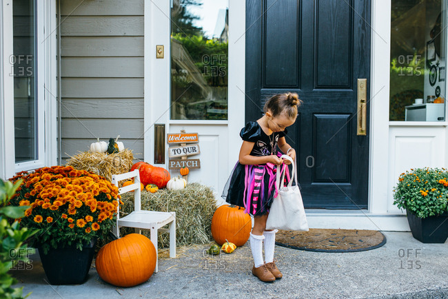 Girl checking her Halloween candy