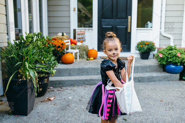 Girl checking her Halloween bag