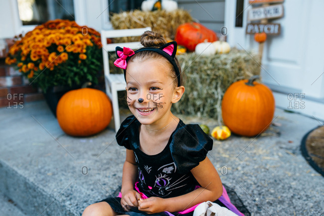Girl in cat costume smiling