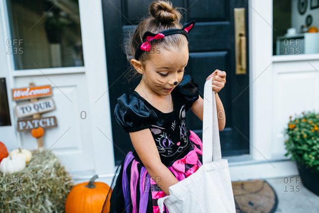 Girl checking out her Halloween candy