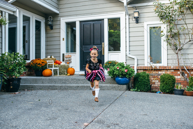 Girl running in Halloween costume