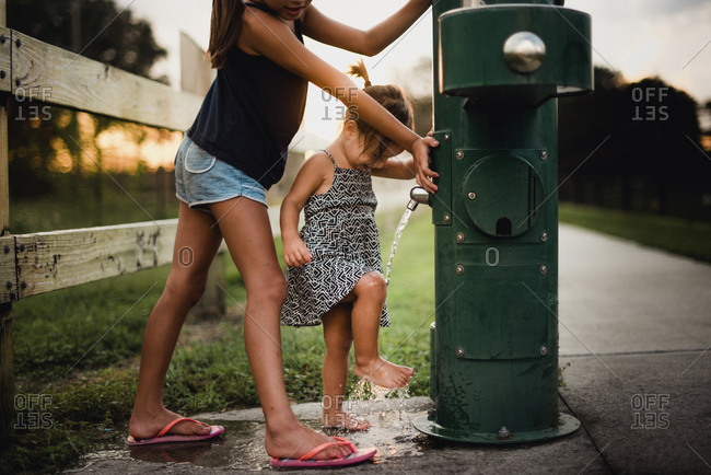 Girls rinsing feet in a park