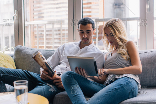 Couple on a couch using a device