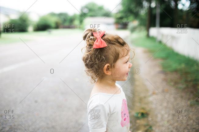 Toddler girl playing in the rain
