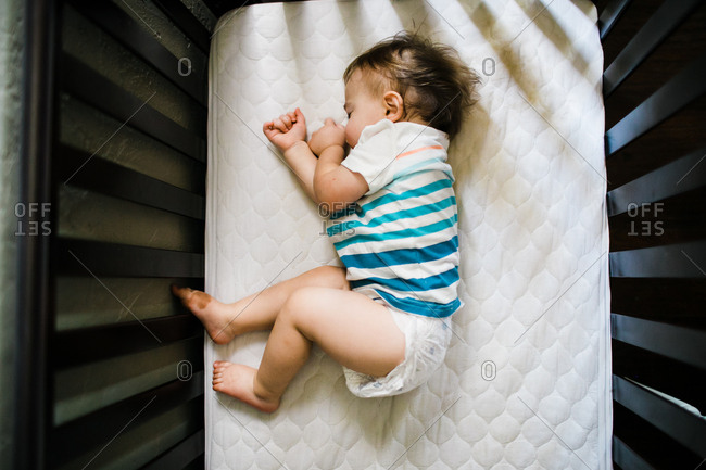 Little baby boy sleeping in crib