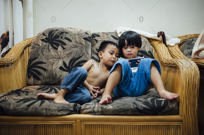 Two boys playing on cell phone