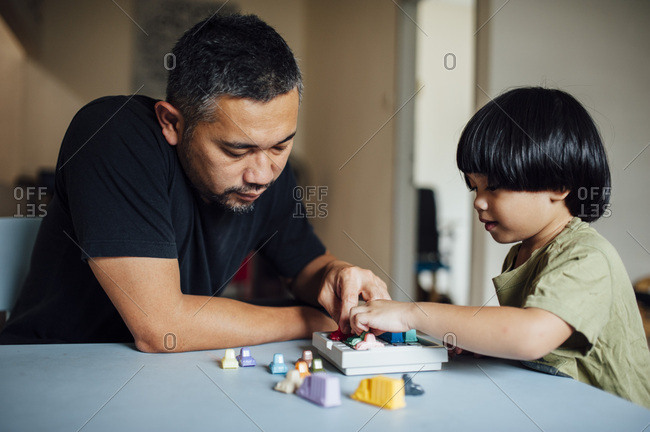 Father and son playing game together